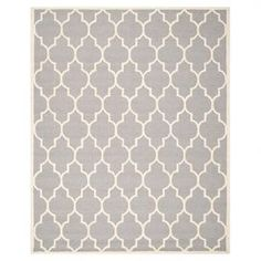 Wool rug with a trellis motif. Hand-tufted in India.  Product: RugConstruction Material: WoolColor: Silver and ivoryFeatures:  Hand-tuftedMade in India Dimensions: 8' x 10'Note: Please be aware that actual colors may vary from those shown on your screen. Accent rugs may also not show the entire pattern that the corresponding area rugs have.Cleaning and Care: Professional cleaning recommended
