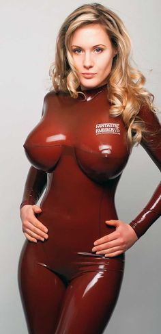 Sexy blonde in her full body red latex cat suit