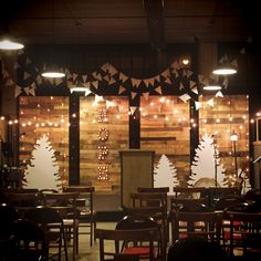 Ronnie Martin from Substance Church in Ashland, Ohio brings us this Nordic-inspired Christmas stage.Against the four pallet walls, they constructed four tree silhouettes out of heavy duty foam core. The white flag bunting was sewn from muslin and thick twine. The bunting, combined with the lights, created a feeling of a snowy, starlit sky.The sermon series through Advent was called