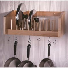 Kitchen Pot and Pan Rack: Organize your Kitchen Made by Woodform out of handcrafted select northern hardwoods, this pot and pan rack not only has six hooks to hang your favorite pots and pans, it conveniently stores the lids on the shelf above. Kitchen Wall Storage, Kitchen Organization, Diy Kitchen, Kitchen Decor, Pot Hanger Kitchen, Hanging Pots Kitchen, Kitchen Dining, Kitchen Walls, Kitchen Layout