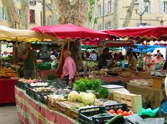 """""""The best part of Southern France is by far their markets, known not only for fresh fruits and vegetables in Olympus-type abundance, but also for local produce-such as packages of lavender and fresh salt."""" Aix-en-Provence, France photo of """"The Provencal Market"""" by IgoUgo travel photographer, Global Nomad."""