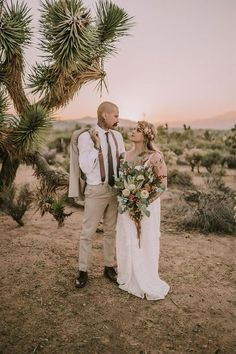 This outdoor wedding venue, Tumbleweed Sanctuary in Joshua Tree, provided an incredible desert landscape and sunset backdrop for this intimate elopement and wedding portrait featuring the boho bride in a white wedding dress with a desert wedding bouquet and the groom in a cream suit with suspenders. #desertwedding #desertelopement #joshuatreewedding Las Vegas Wedding Photographers, Las Vegas Weddings, Elopement Inspiration, Elopement Ideas, Elopement Wedding, Destination Wedding Locations, Destination Wedding Photographer, Cream Suit, Joshua Tree Wedding