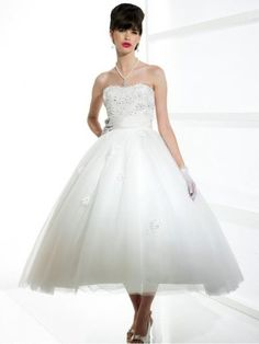 This tea length ball gown Silhouette wedding dresses featuring a Satin sash at waist. Soft sweetheart / Open back.  Fabric: Tulle/Taffeta Embellishment: Beaded Silhouette:Ball Gown Straps:Strapless Sleeves: Sleeveless Neckline: Soft sweetheart / Open back Waist:Natural waist  Back: Zipper up Hemline: Tea length $159.99