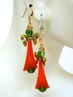Made in traditional Christmas red and green with a little gold, these holiday angel earrings are sure to delight you!  The short handmade earrings are made with genuine Swarovski Austrian crystals, Lu
