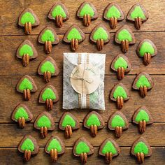Mint Chocolate Tree Cookies #recipe http://www.bhg.com/recipe/mint-chocolate-trees/ --  Treat yourself to a handful of minty green Christmas cookies. Make them in just four simple steps with the help of homemade dough, food coloring, and pecan halves for the chipper tree trunks.