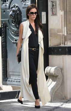 Victoria Beckham wearing cream cape-style coat and Casadei Blade Suede pumps at Paris. September 27, 2013
