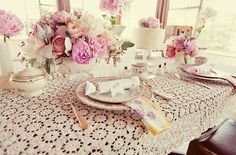 vintage floral centerpieces in pink and blush with lace table cloth