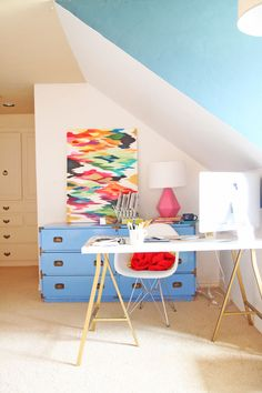 Blue and white walls paired with vintage furniture and Ikea hacks. Painting by Rita Ortloff.