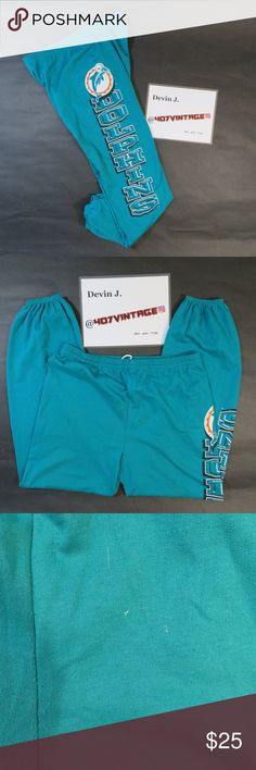 VTG Miami Dolphins Sweatpants USED Vintage NFL Miami Dolphins Spellout 3D Logo Turquoise Cotton Sweatpants | MENS size XL | Good condition, flaws are shown in pictures  For Discounts Follow Me on Instagram @407vintage !  KEYWORDS/TAGS: ultra boost , Tommy Hilfiger , Polo Sport , Nautica , NMD , supreme , kith , bred , adidas , banned , french blue , stussy , Maestro , vintage , kaws , solefly , trophy room , box logo , gamma blue , retro jordan , steal , foams , foamposite , rare , nike air…