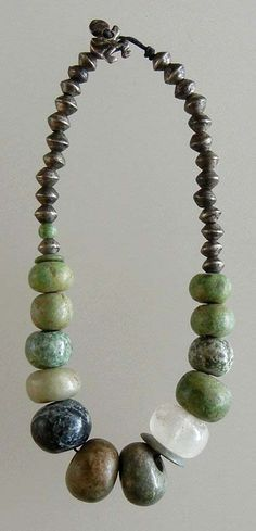 Necklace made up of beautifully shaped pre Columbian greenstone.which is a form of green nephrite jade (including one quartz) combined with Ethiopian flying saucer beads at the back. Tribal Jewelry, Jewelry Art, Beaded Jewelry, Silver Jewelry, Jewelry Accessories, Jewelry Necklaces, Handmade Jewelry, Jewelry Design, Beaded Necklace