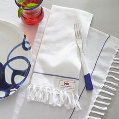 double duty: placemat can be used as napkin  Como Placemat-Napkin with Fringe - Crate & Barrel   domino.com