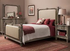 Bring the look of hand-carved furniture to your master bedroom with this Whitmore 4-piece king bedroom set. Reminiscent of old-world craftsmanship, each piece is artfully detailed with decorative carvings, reeding and beading, and done in stunning wire-brushed white oak veneers. Cream linen covers the padded headboard and footboard for comfort and added style.