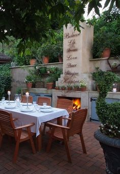 outdoor living area- love the words above the fireplace