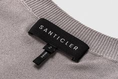 Santicler Knitwear on Behance Label Design, Branding Design, Print Design, Clothing Logo, Clothing Labels, T Shirt Label, Clothing Packaging, Design Theory, Fabric Labels