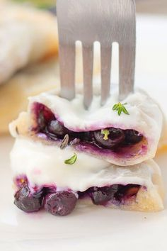 Try my easy recipe for the best homemade sweet Polish blueberry pierogi filled with frozen blueberries and fresh thyme leaves! These authentic Polish sweet dumplings can be prepared ahead of time and frozen. #pierogi #polish #authentic #dessert #easyrecipes