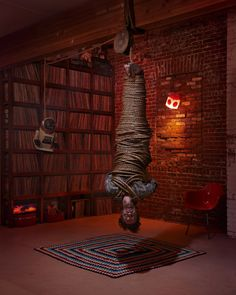 man wrapped in rope like a mummy hanging upside down, like a bat, Narrative Photography by Ryan Schude