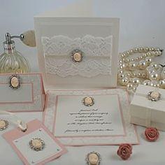 Wedding invitation with antique brooch look