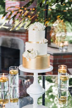 Gold and white pearl embellished wedding cake: http://www.stylemepretty.com/2016/09/02/napa-valley-garden-party-small-wedding/ Photography: Jana Williams - http://jana-williams.com/