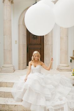 Love the Balloons! Would be super cool to have a hot pink sash on the wedding dress and match with hot pink balloons!