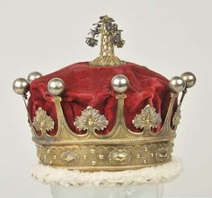 King George IV (1762-1830). The Earl of Westmorland's Coronet, 1821, a silver-gilt and crimson velvet coronet, lined in ivory silk, trimmed in ermine, and with a central gilt and silver thread tassel, fully hallmarked London 1820/1, and with maker's mark for Robert Garrard.