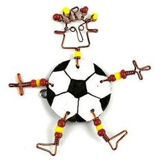 This handmade novelty dancing girl pin features a playful soccer ball design made from recycled tin can and copper wire, accented with colorful Maasai beads. Pin is approximately 3 inches tall. Girls Soccer, Girls Earrings, Girl Dancing, Red Apple, Soccer Ball, Fair Trade, Brooch Pin, Recycling, Alternative