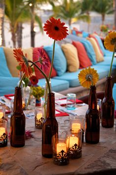 beer bottles + flowers :) event by signaturemexico.com, photo by mangoweddings.net