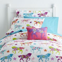 This fun horse-themed comforter for kids gives your little cowgirl a cozier spot for sleep, study and play. Covered in pretty horses, flowers and stars.