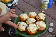 Orange rolls cooked in oranges over a fire: need oranges, pillsbury grands, orange flavor rolls and or course a campfire! cut oranges in half, scoop out the insides, place one orange roll in each orange half, cover w/ foil and cook over fire, frost when done