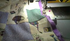 Purple Gardening Quilt - putting a purple peeper around the quilt before the borders go on.