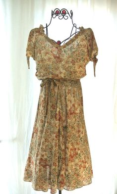 0b32a6c67d8 vintage boho chic floral dress paired with oversized cardigan and lace-up  boots + pearl