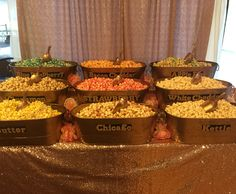 Popcorn bar with gold tubs and blush sequin tablecloth