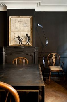 We love the contrasting look of these classic Windsor chairs against the black walls.  Beautifully paired. View our website for a selection of antique painted black furniture, and handmade Windsor chairs #WindsorChairs