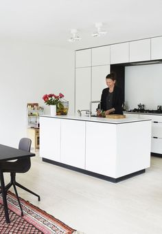 Nordic inspired kitchen - simple Nordic lines meet warm and vibrant patterns and colours. The kitchen island adds extra table space and storage space in the kitchen
