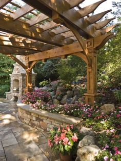 Gorgeous garden trellis and landscaping with a nice transition. Exceptional outdoor fireplace