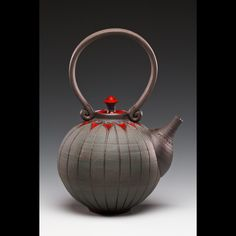 Larry Allen | Sanibel Art Fair.  All vessels are made out of black or red stoneware clay, thrown on a potter' wheel and decorated with a sgraffito design