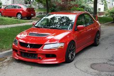 Red Mitsubishi Lancer Evolution VIII