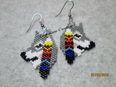 These native american horse earrings are made from glass delica beads. and are 1-1/8 x 2-3/8 inches long including the ear wire.  This is a