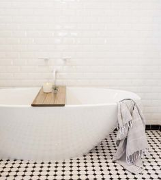 Black and white bath with modern freestanding tub.