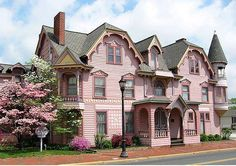 This large mauve house is a Victorian in the Queen Anne style & so stunning.