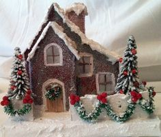 glitter house from a kit plus more  love the garland on the fence