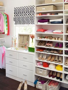 This closet design helps with organization by keeping everything visible at all time with smaller shelves for shoes and accessories.