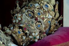 The jeweled skeletons were originally found in catacombs beneath Rome in 1578, and distributed as replacements under the belief they were Christian martyrs to churches that had lost their saint relics in the Reformation. However, for most, their identities were not known. The receiving churches then spent years covering the revered skeletal strangers with jewels and golden clothing, even filling their eye sockets and sometimes adorning their teeth with finery.