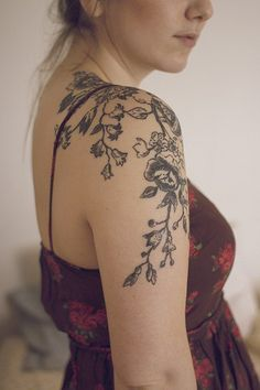 Floral tattoo, love the pattern and placement, maybe even in white or blush ink.