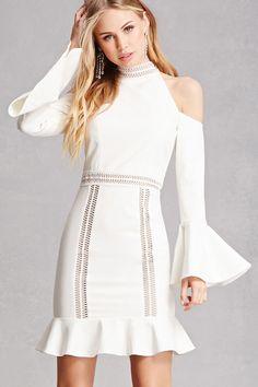 A woven mini dress by Dark Pink™ featuring an open-shoulder cut, crochet trim mock neckline, long sleeves with bell cuffs, ruffle hem, piped crochet trim, and a concealed back zipper.