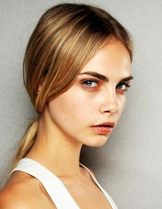 Cara Delevingne is bang on trend with her low slung ponytail