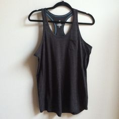 NWT Black Racerback Tank Brand new with tags. Looks oversized a bit. Women's size large. Has front chest pocket. Energy Zone Tops Tank Tops