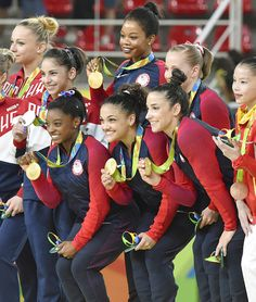 #RIO2016 Members of the US women's gymnastics team hold their gold medals during the award ceremony at the Rio de Janeiro Olympics on Aug 9 2016 The United...