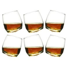 """Who is tipsy?  Not me!  It must be the glasses!   If you are sipping from this set of Rocking Glasses then that is absolutely true!  These fun and functional whiskey glasses actually rock when set down from a rounded base on the bottom.   Perfect for a party and as a gift.  Let  Happy Hour begin!  Set of 6 glasses  Capacity  6 3/4 oz  Size  3 1/2"""" h, 3"""" w"""