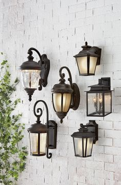 Light up your front porch with a beautiful outdoor light fixture. There's no better time than now to get ready for warmer weather. Enjoy evenings on the porch with a little glowing light. These outdoor sconces are the perfect addition to your home. Available at Home Decorators Collection.