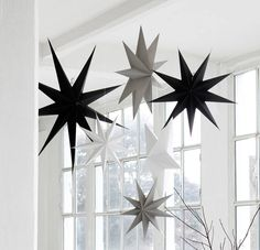 large paper stars in black white and grey